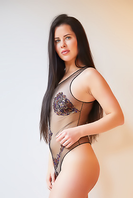 /Cassie Fire Poses In Sexy Lingerie And Takes It Down