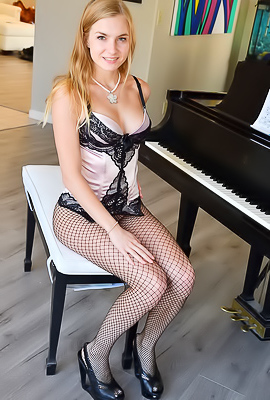 /Angelina FTV Angelina FTV rides a dildo when playing a piano