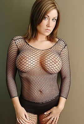 /Hot and serious babe Krissy in sexy black fishnets